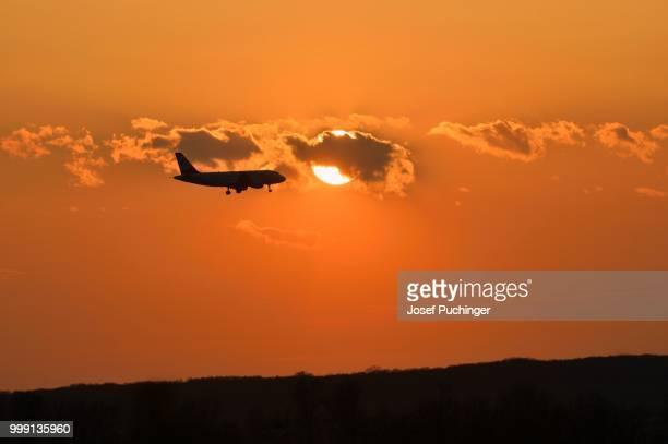 Jet landing at sunset, Schwechat near Vienna, Austria