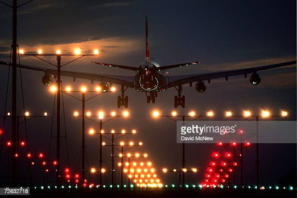 A jet lands at Los Angeles International Airport on Thanksgiving eve traditionally the busiest travel day of the year November 22 2006 in Los Angeles...