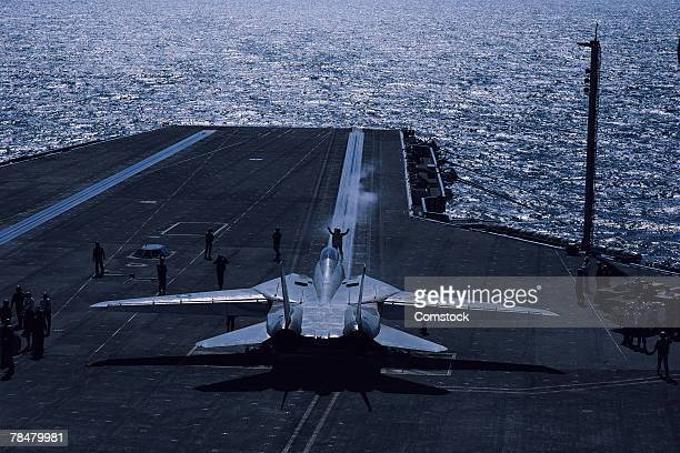 Jet on aircraft carrier