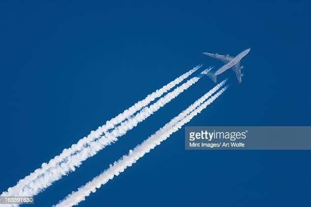 Jet plane in flight, Alaska, USA