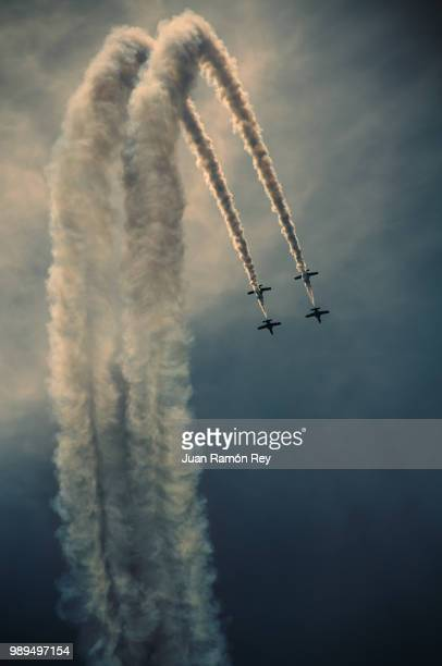 Jet planes flying in formation creating a trail.