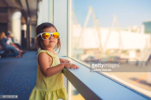 jet set toddler at airport in sunglasses - toddler at airport stock pictures, royalty-free photos & images