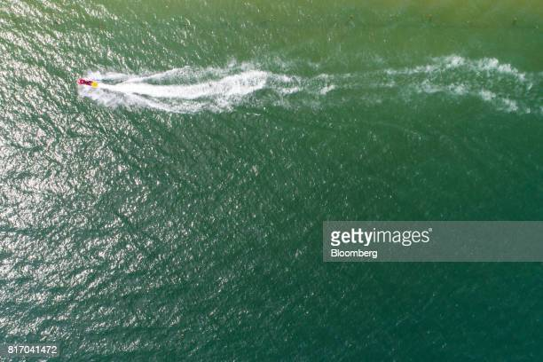 A jet ski travels off shore in this aerial photograph taken above Haeundae beach in Busan South Korea on Sunday July 16 2017 South Korea's minimum...