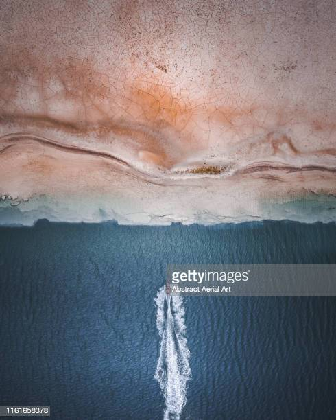 jet skier heading towards the land, south coast of england, united kingdom - halved stock pictures, royalty-free photos & images
