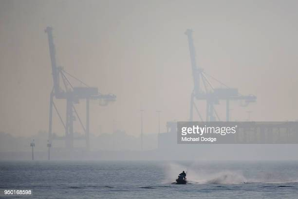 A jet skier travels along the StKilda foreshore on April 23 2018 in Melbourne Australia Melbourne has been experiencing unseasonably warm weather in...