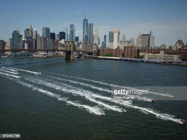 Jet skiers ride in the East River, June 9, 2018 in New York City. Hundreds of watersports enthusiasts from around the tri-state area joined what...