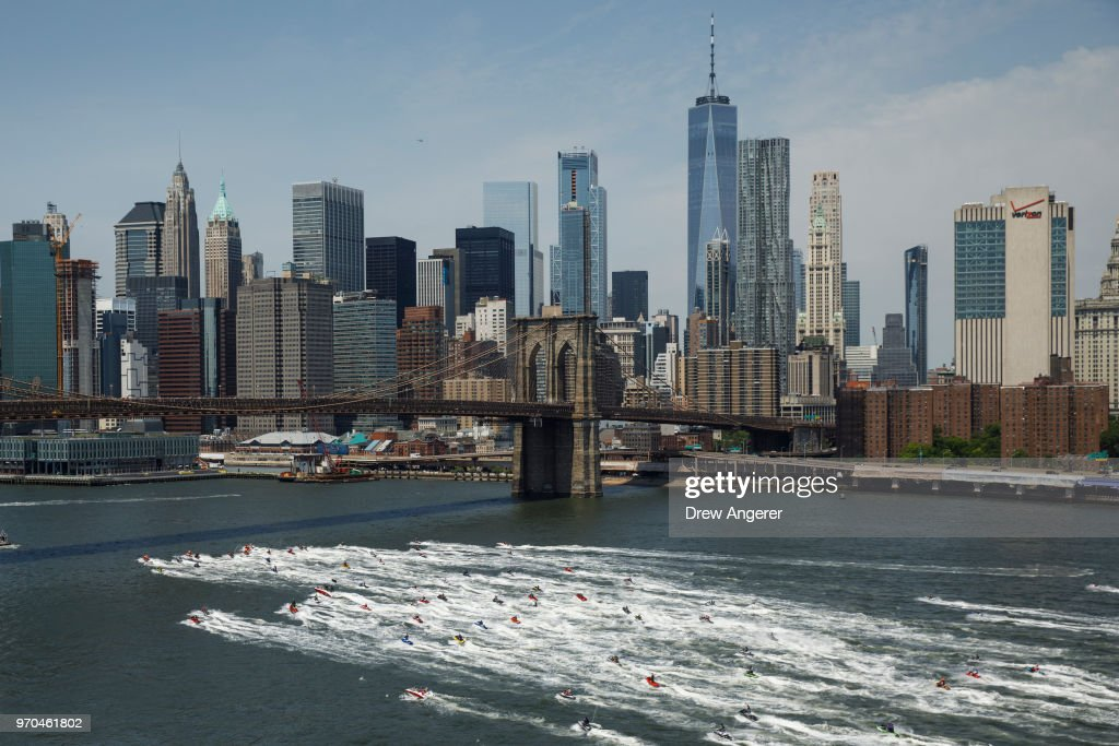 Hundreds of watersports enthusiasts took part in a group jetski around the island of Manhattan