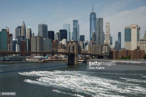 Jet skiers ride in the East River June 9 2018 in New York City Hundreds of watersports enthusiasts from around the tristate area joined what...