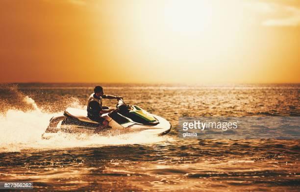 Jet skiing at sunset.