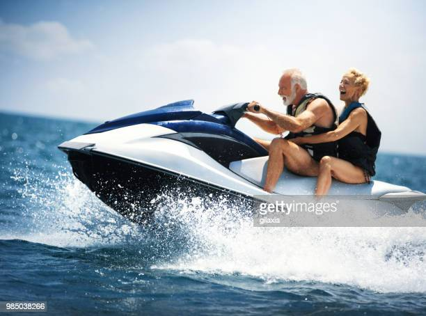 jet skiing. - jet ski stock pictures, royalty-free photos & images