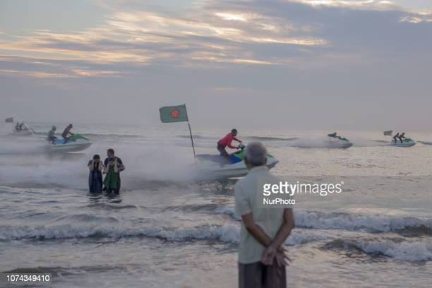 Jet skiing with Bangladeshi flag in the world longest beach Coxbazar Bangladesh durinf Victory Day Of Bangladesh celebration on 16 December 2018