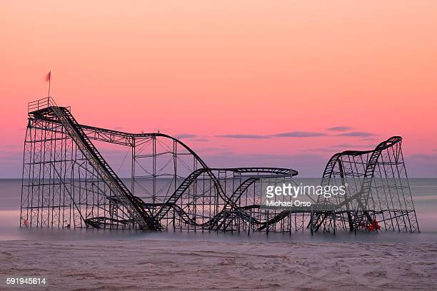 Jet Star roller coaster in the atlantic ocean from Hurricane Sandy during sunset. Seaside Heights, NJ