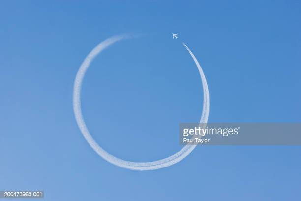 Jet vapour trail making circle in sky (Digital Enhancement)