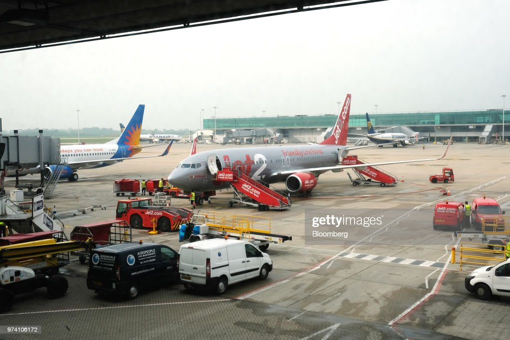 A Jet2 aircraft, a Boeing 737 named 'Jet2Bob Gruszka', owned by Dart Group Plc, sits on the tarmac after landing at London Stansted Airport in Stansted, U.K., on Thursday, May 31, 2018. Dart Group Plc rose the most in almost three years after the owner of U.K. discount airline Jet2 said full-year earnings will be higher than expected as airfares increase. Photographer: Bryn Colton/Bloomberg via Getty Images