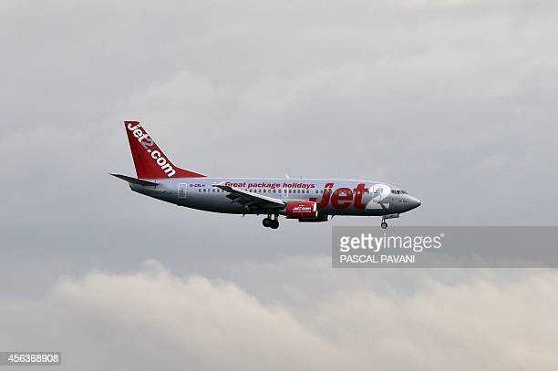 A Jet2 aircraft lands at the ToulouseBlagnac airport on September 29 2014 AFP PHOTO / PASCAL PAVANI