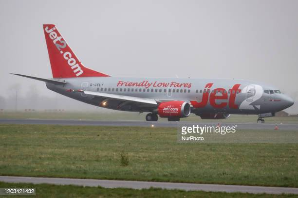 Jet2 Boeing 737300 aircraft as seen landing during weather with fog mist and a storm at Amsterdam Schiphol AMS EHAM International Airport on February...