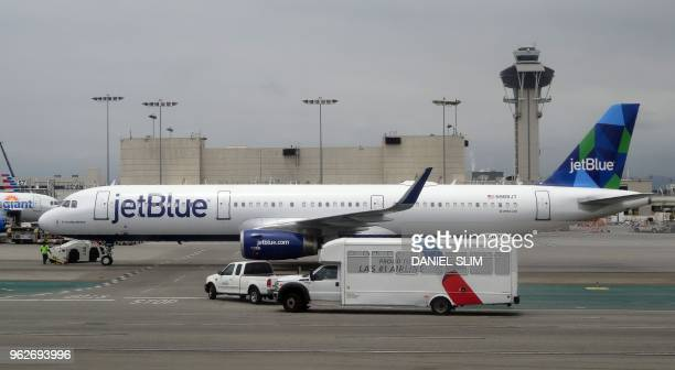 A JetBlue Airlines Airbus A321200 taxis at Los Angeles International Airport on May 24 2018