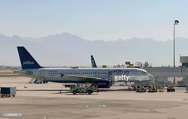 JetBlue Airlines plane is seen at a gate at Salt Lake City International Airport , Utah, on October 8, 2020.