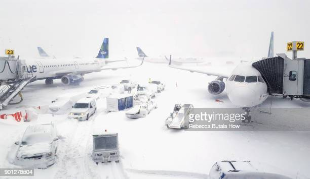 JetBlue airplanes wait at the gates outside terminal five at John F Kennedy International Airport on January 4 2018 in the Queens borough of New York...