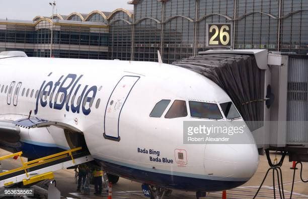 JetBlue Airways Airbus A320 jet is serviced at a gate at Ronald Reagan Washington National Airport in Washington DC