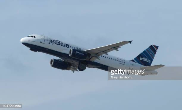 A jetBlue Airways airplane takes off from Newark Liberty Airport on September 30 2018 as seen from Elizabeth New Jersey