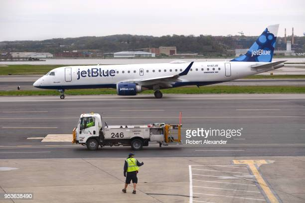 JetBlue Airways Embraer 190 jet taxis to a gate after landing at Ronald Reagan Washington National Airport in Washington DC