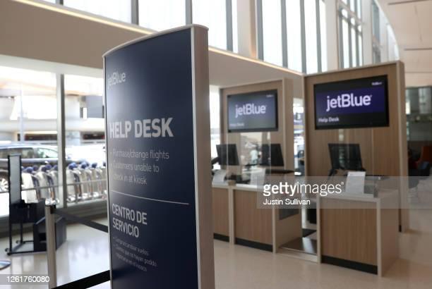 JetBlue Airways help desk sits empty at San Francisco International Airport on July 28, 2020 in San Francisco, California. JetBlue Airways reported a...