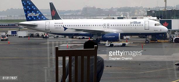 JetBlue Airways jet rests at it's gate awaiting passengers at LaGuardia Airport September 17 2004 in New York City JetBlue Airways New York's lowfare...