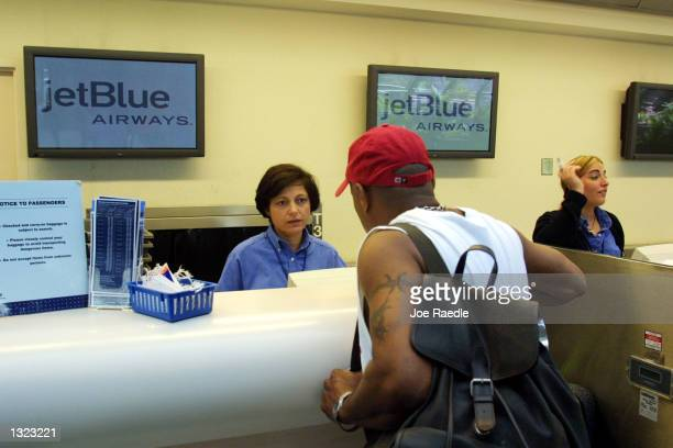 JetBlue Airways ticket agent Nella Sabogal left issues a plane ticket June 19 2001 at the Ft Lauderdale/Hollywood International airport in Ft...