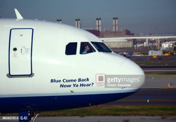 JetBlue passenger jet taxis at LaGuardia Airport in New York New York