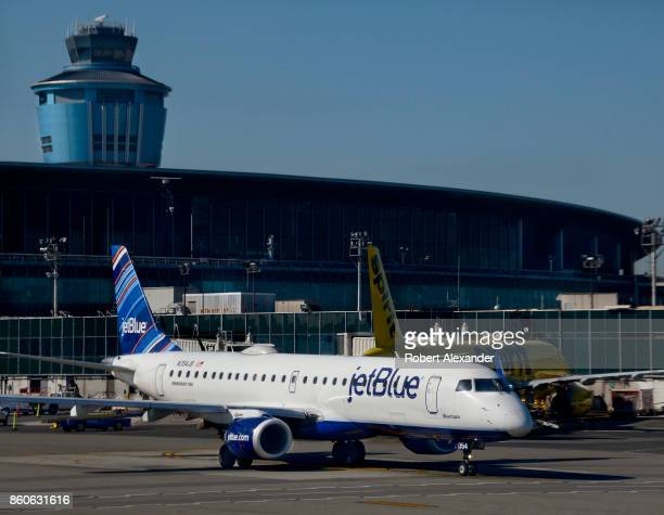 JetBlue passenger jet taxis at LaGuardia Airport in New York New York