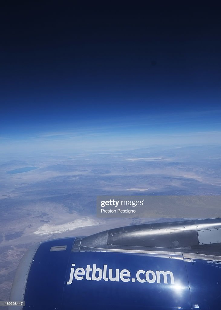 A JetBlue plane flies May 1, 2014 in flight over the United