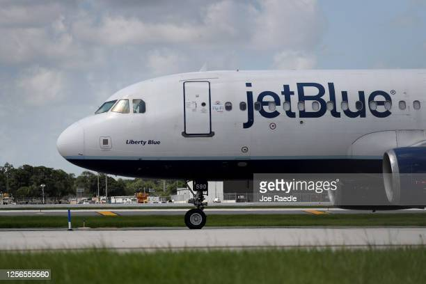 JetBlue plane prepares to take off from the Fort Lauderdale-Hollywood International Airport on July 16, 2020 in Fort Lauderdale, Florida. JetBlue...