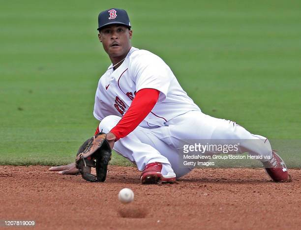 Jeter Downs of the Boston Red Sox falls just before missing a bad hop hit during a spring training game against Northeastern University at JetBlue...