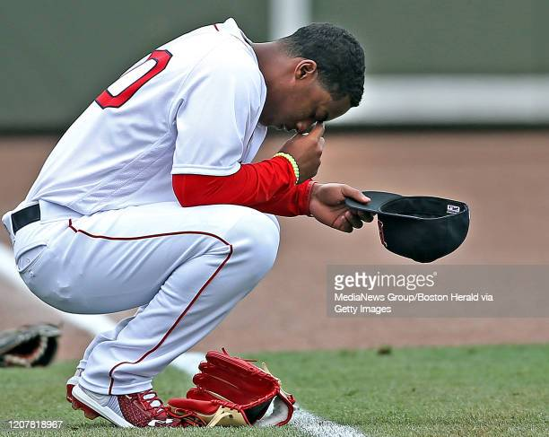 Jeter Downs of the Boston Red Sox prays before a spring training game against Northeastern University at JetBlue Park on February 21 2020 in Fort...