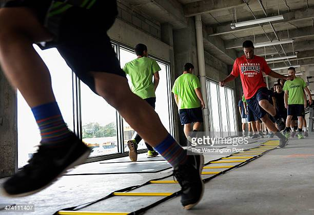 Jeter Downs right joins other high school students in a strength and conditioning class at SLAM Miami on January 14 2014 Sports Leadership and...