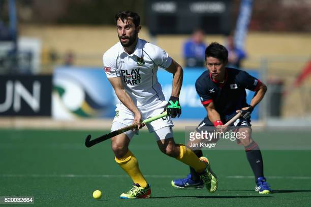 Jethro Eustice of South Africa attempts to get away from Koji Yamasaki of Japan during the 9th/10th place play off match between Japan and South...