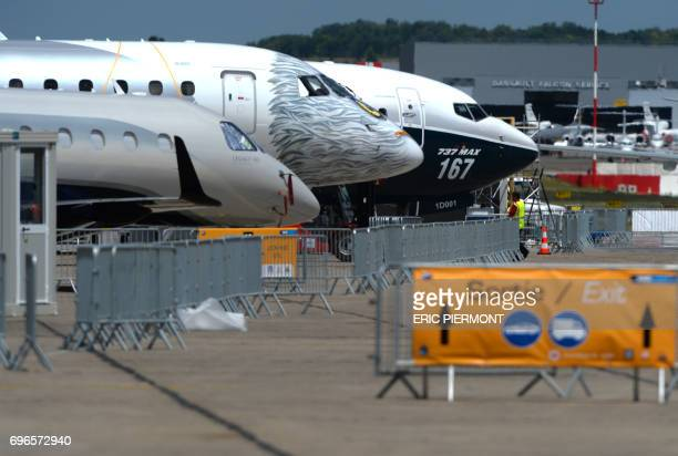 Jetliners stand on the tarmac on June 16, 2017 in le Bourget near Paris prior to the opening of the International Paris Air Show on June 19. / AFP...