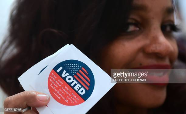 Jetoi Johnson displays California's multilanguage I Voted sticker for those who vote at the Los Angeles County Registrar's Office in Norwalk...