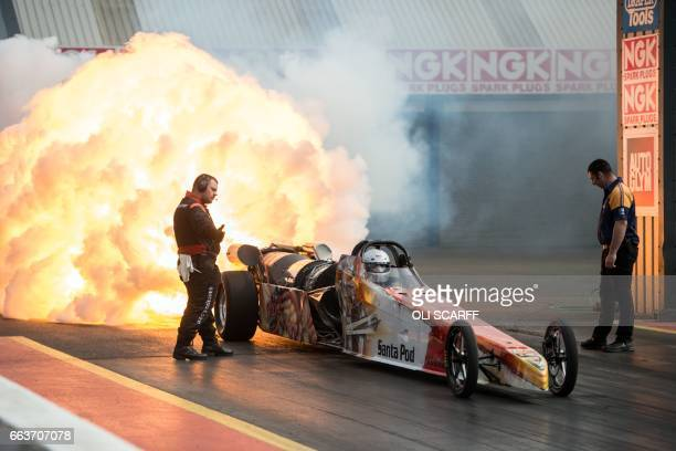 TOPSHOT A jetpowered dragster takes part in The Fast Show performance car event held at the Santa Pod Raceway near Wellingborough central England on...