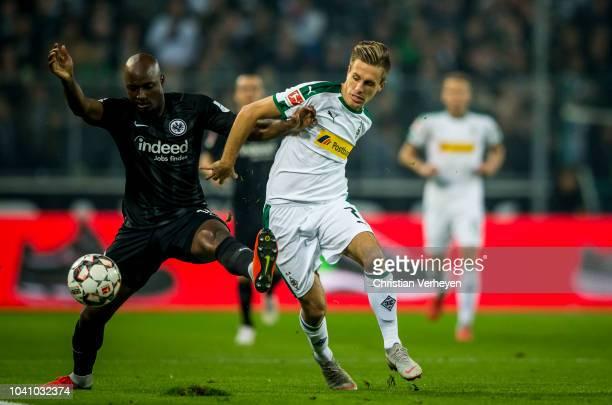 Jetro Willems of Eintracht Frankfurt and Patrick Herrmann of Borussia Moenchengladbach battle for the ball during the Bundesliga match between...