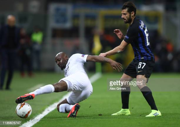 Jetro Willems of Eintracht Frankfurt battles for possession with Antonio Candreva of FC Internazionale during the UEFA Europa League Round of 16...