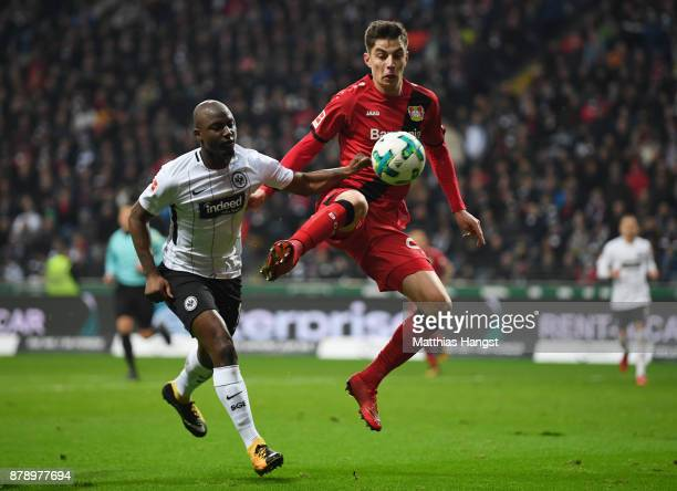 Jetro Willems of Frankfurt and Kai Havertz of Leverkusen compete for the ball during the Bundesliga match between Eintracht Frankfurt and Bayer 04...