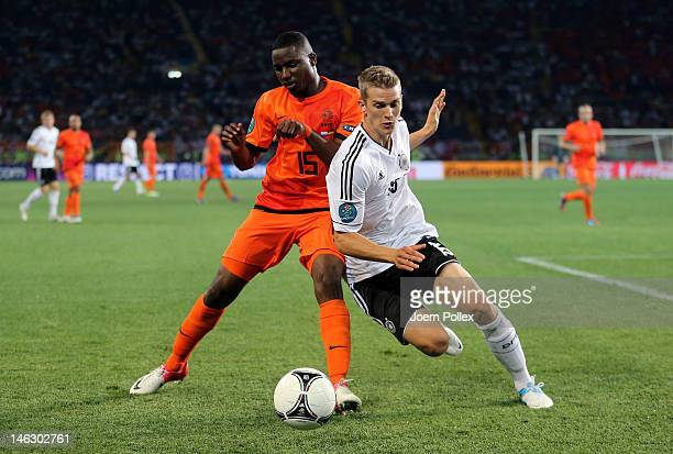 Jetro Willems of Netherlands and Lars Bender of Germany battle for the ball during the UEFA EURO 2012 group B match between Netherlands and Germany...