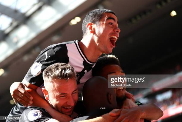 Jetro Willems of Newcastle United celebrates with Miguel Almiron after scoring his team's first goal during the Premier League match between...