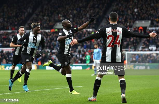 Jetro Willems of Newcastle United celebrates with teammates Allan Saint-Maximin and Miguel Almiron of Newcastle United after scoring his team's first...