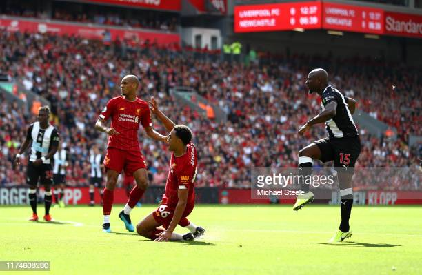Jetro Willems of Newcastle United scores his team's first goal during the Premier League match between Liverpool FC and Newcastle United at Anfield...