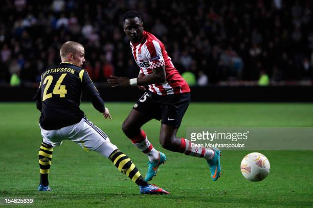 Jetro Willems of PSV and Daniel Gustafsson of AIK battle for the ball during the UEFA Europa League Group F match between PSV Eindhoven and AIK Solna...