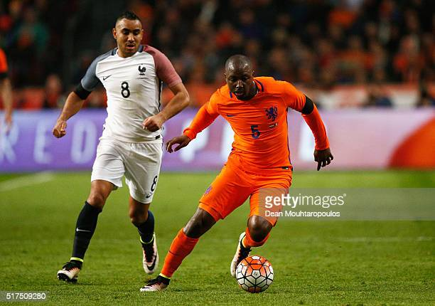 Jetro Willems of the Netherlands goes past Dimitri Payet of France during the International Friendly match between Netherlands and France at...