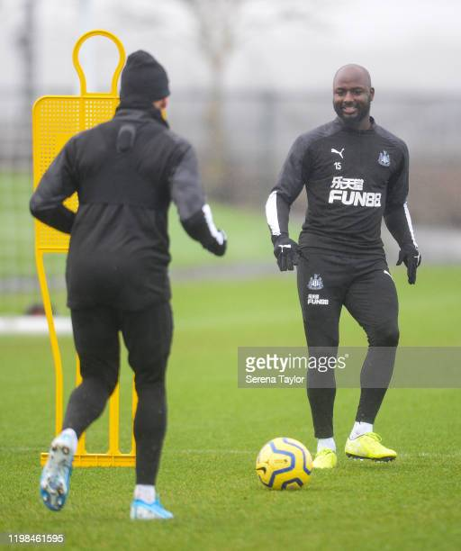 Jetro Willems passes the ball to Dwight Gayle in a ball drill during the Newcastle United Training Session at the Newcastle United Training Centre on...